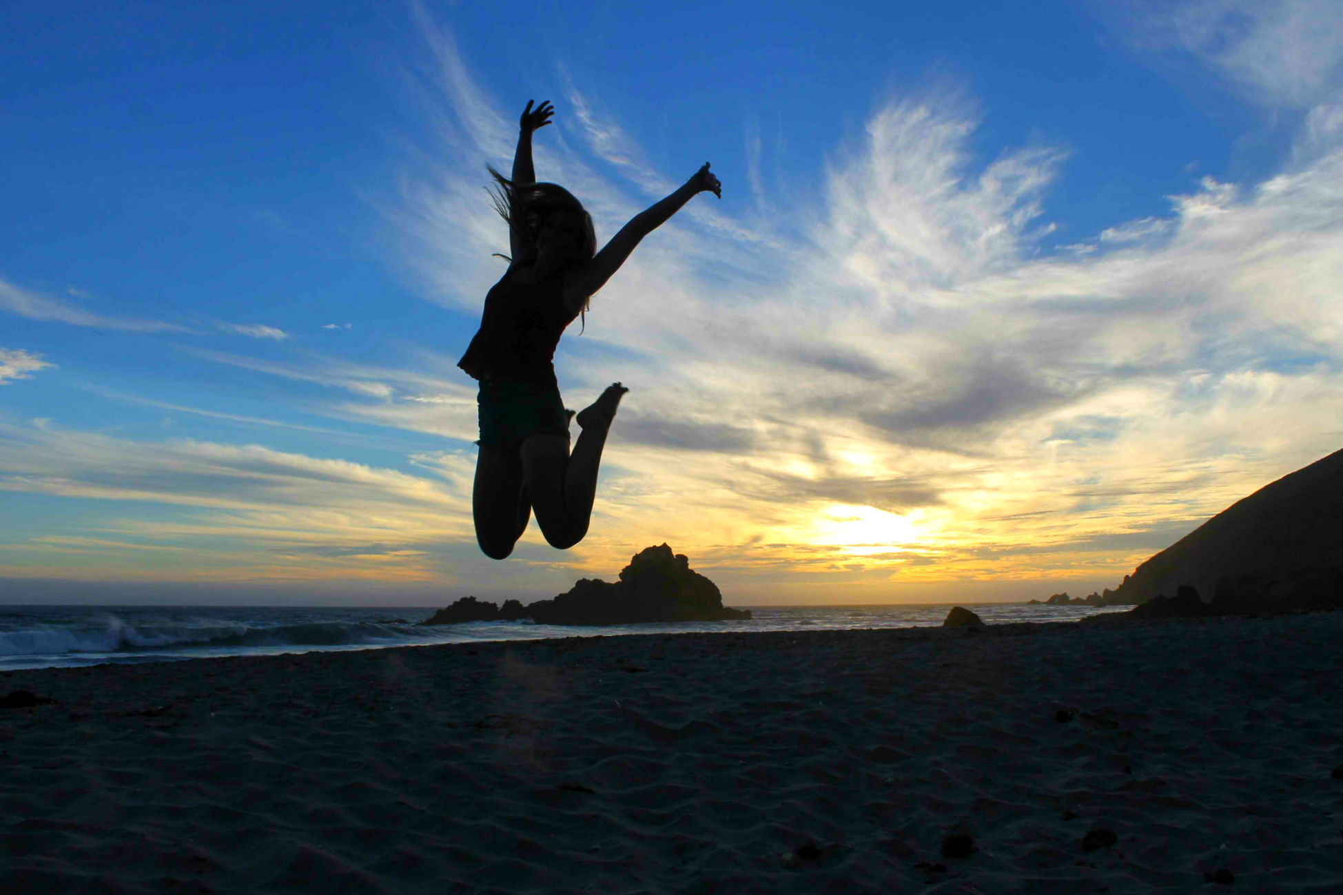 Jumping for joy in Big Sur, California